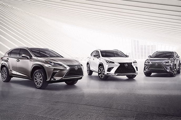 a car lineup of three different lexus car models with a bright white abstract background