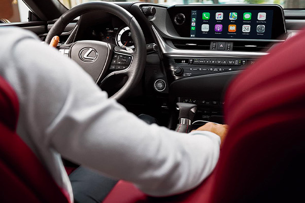 Interior shot of a driver in the front seat of a Lexus sedan