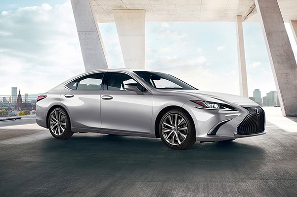 Silver 2020 Lexus ES parked with a city skyline in the background