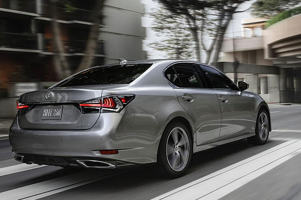Rear view of a silver 2020 Lexus GS in action
