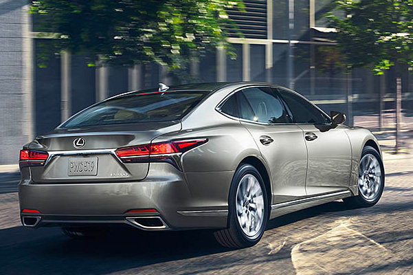 Rear view of a 2020 Lexus LS in action