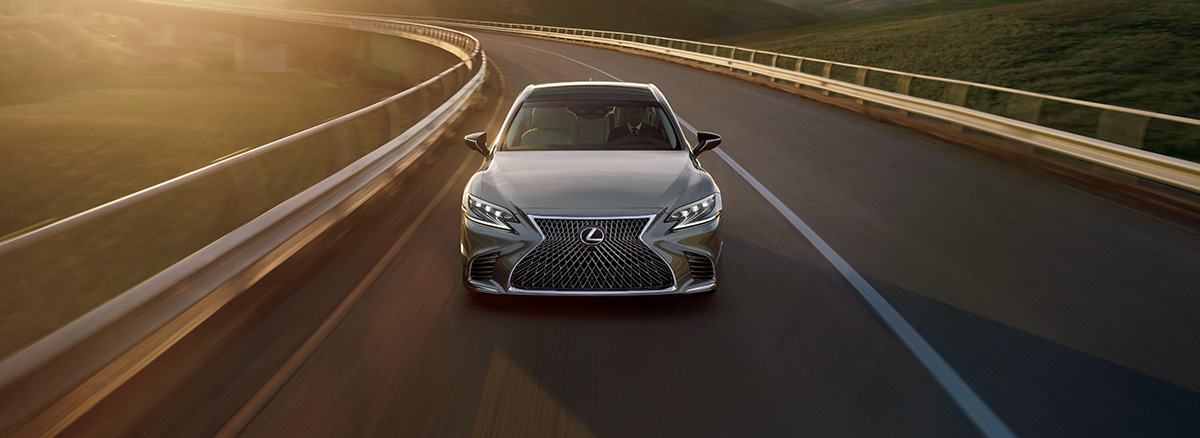 The 2019 LS driving on highway in sunset