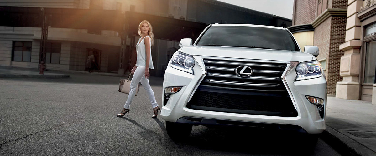 Woman next to Lexus GX