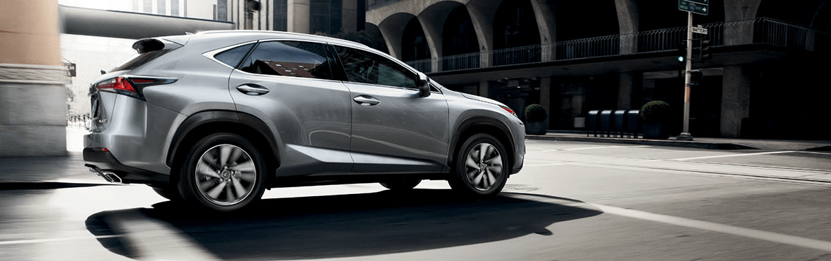 The 2019 Lexus NX driving in city