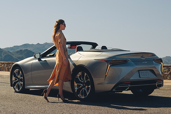 2021 Lexus LC 500 convertible parked with woman