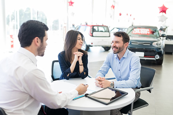 Customers sitting down with finance manager
